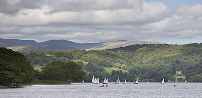Sail boats on Coniston Water at glamping site in Lake District
