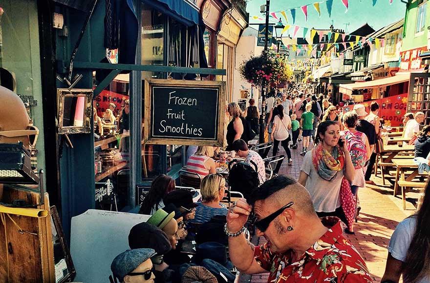 Bustling stalls and cafes in Kensington Gardens, Brighton North Laine