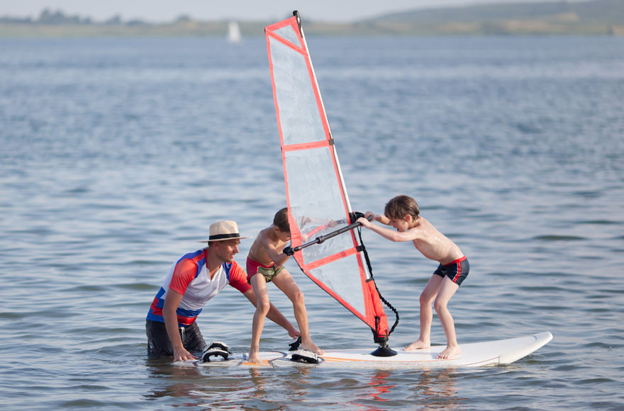 Children learning to windsurf