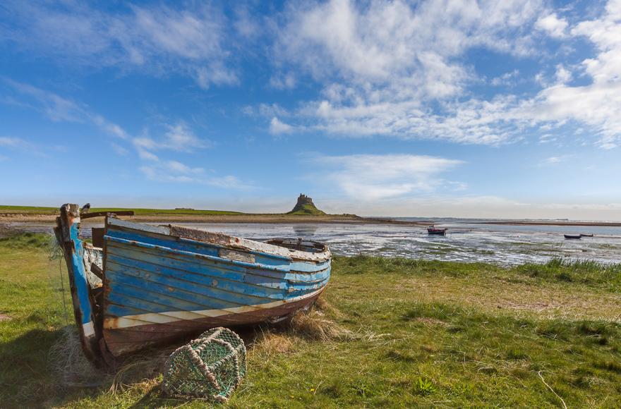 An abandoned fishing boat near Lindisfarne Castle