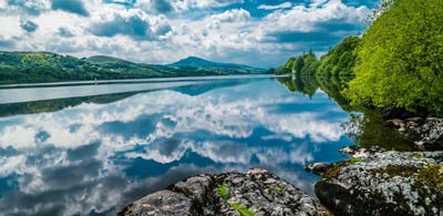 Bala lake reflecting sky and distant mountains