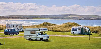 Caravan, motorhome and campervan overlooking waters at Dunnet Bay campsite
