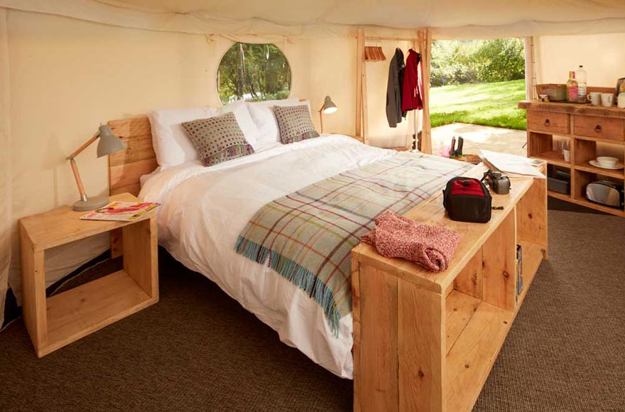 Enjoy plenty of space and a comfy king sized bed in our luxurious yurts
