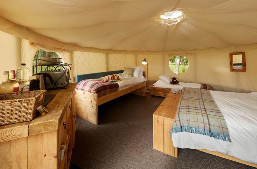Our yurts are decked out with rustic, reclaimed beds and furniture