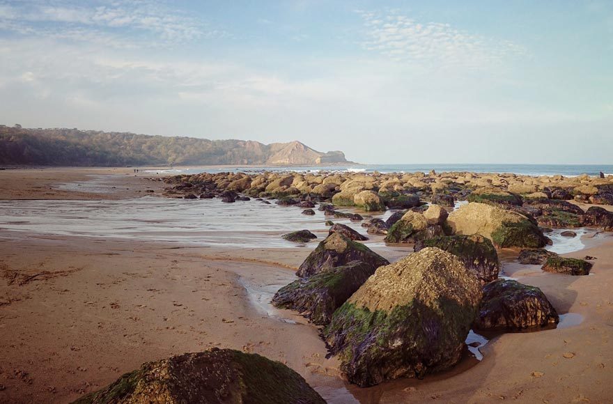 Take a walk on Cayton beach at low tide