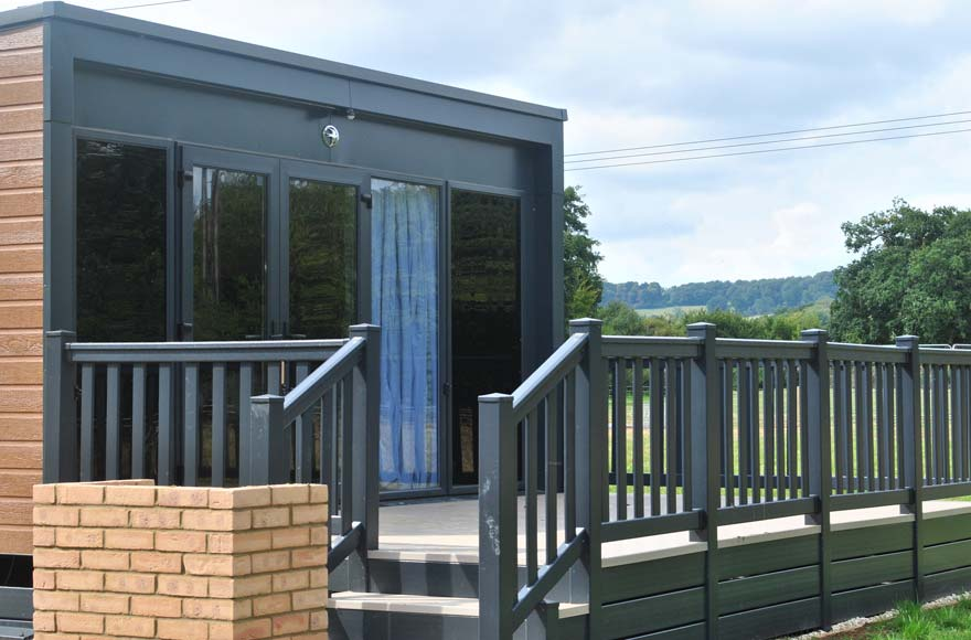 Glamping pods are fitted with your own veranda and brick BBQ station