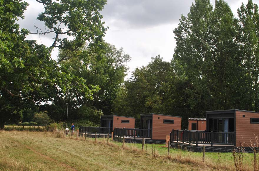 Countryside meet pods, pods meet countryside - look out across the fields from your private terrace