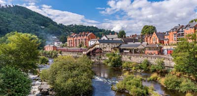 Trees and river with views of picturesque Llangollen town