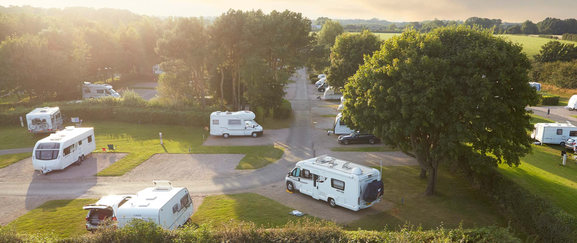 Caravans and motorhomes pitched up at Black Horse Farm Caravan and Motorhome Club Site