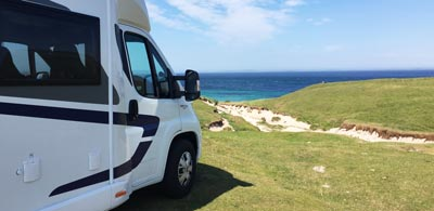 Motorhome overlooking waters at John O' Groats
