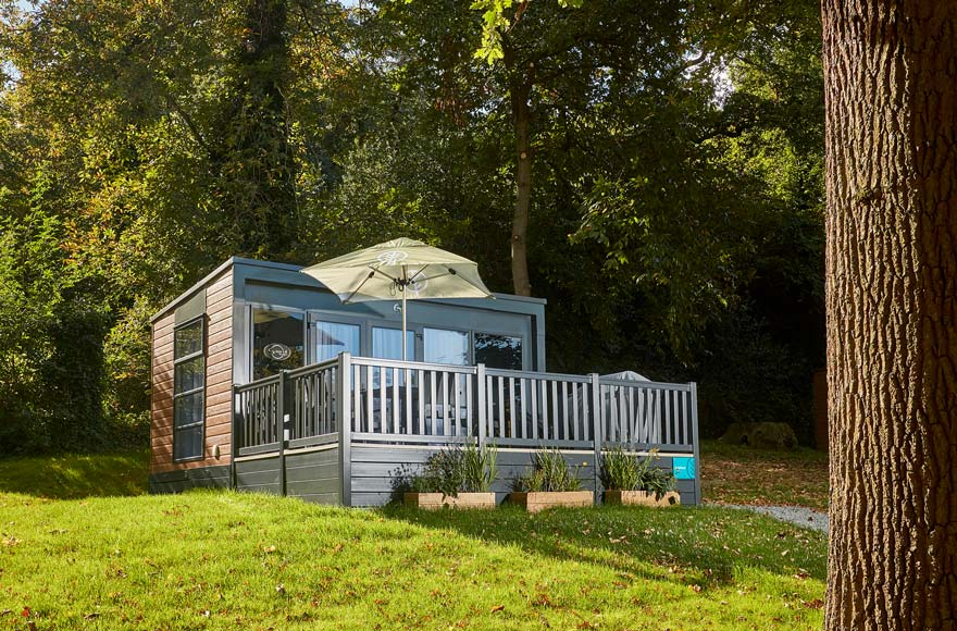 Glamping pod with outdoor area including parasol