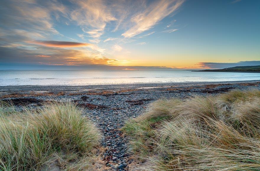 Watch spectacular sunrises over New England Bay