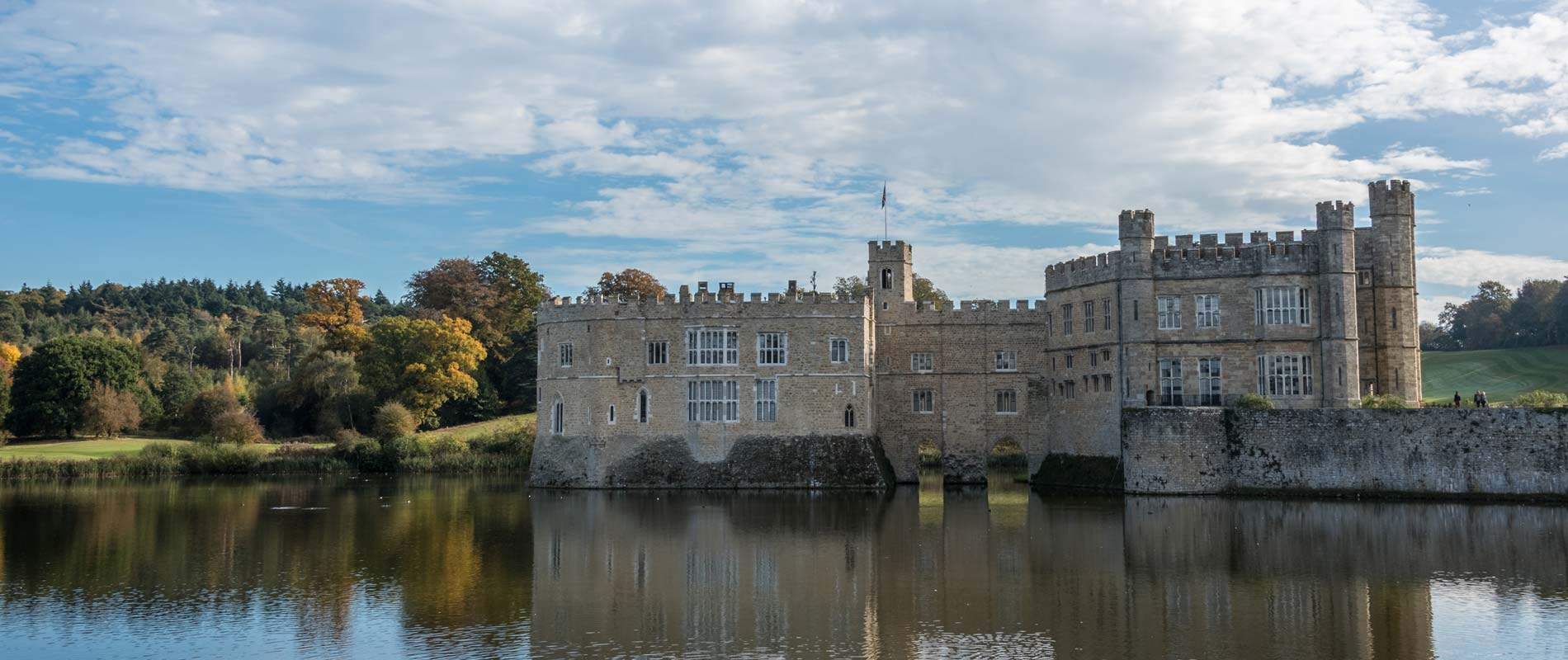 Leeds Castle in Kent surrounded by trees and lake