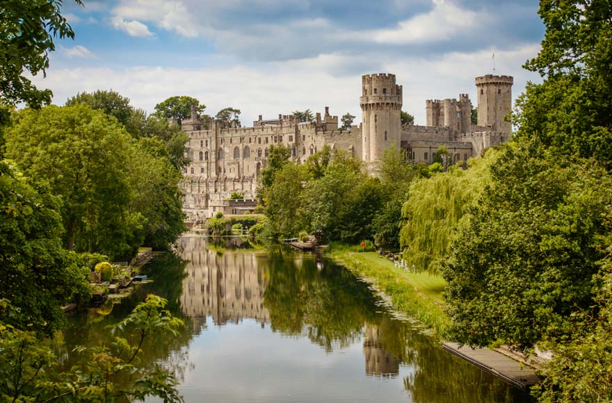 Stunning Warwick Castle peeks out from behind the trees