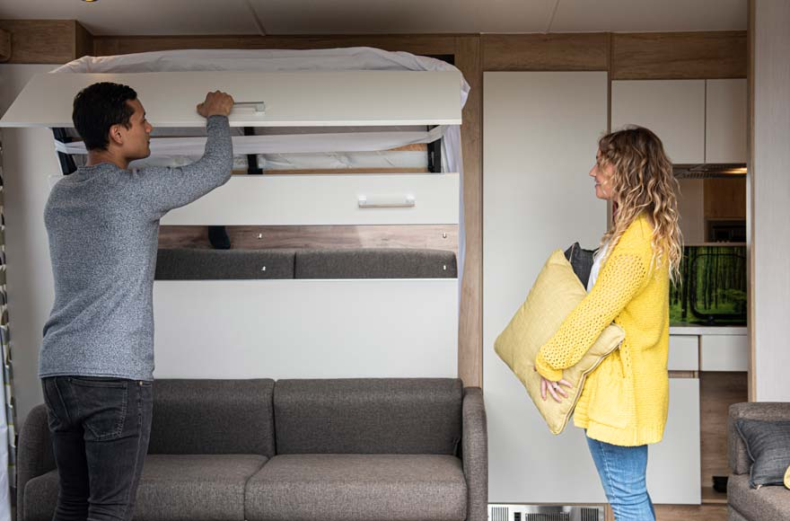 The pod's space-saving design sees your comfy double bed pull down from the wall...