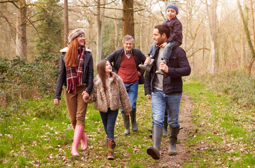 Multi-generational family taking a walk in the Surrey countryside