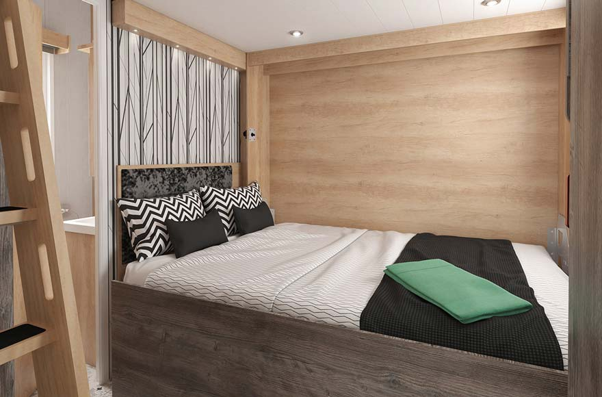 Pull down bed in glamping cabin