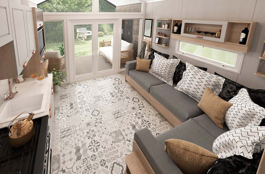 Glamping cabin living area with sofas and kitchen