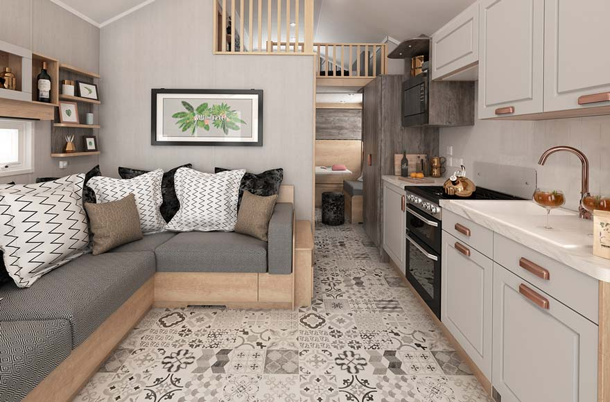 White and copper kitchen and grey sofa setup