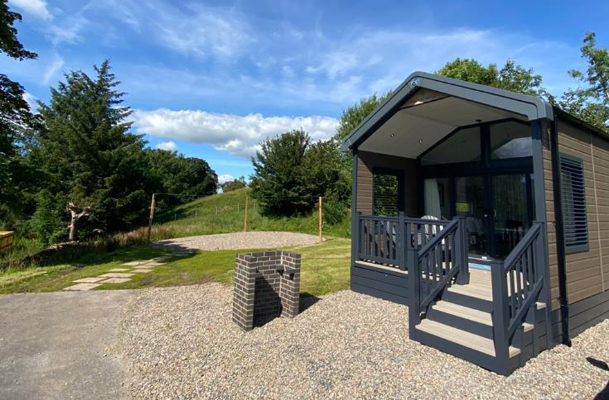 Modern glamping cabin with external bbq area